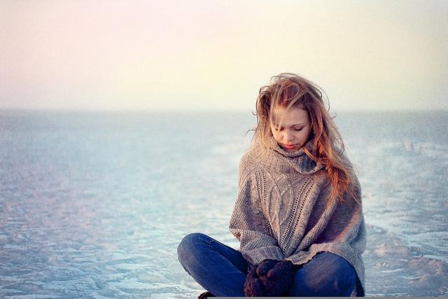 sad-woman-near-ocean-winter